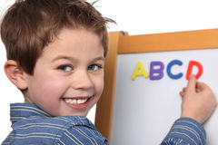 Young boy learning the ABC Stock Photos
