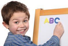 Young boy learning the ABC. Cute young boy learning the ABC Royalty Free Stock Photo