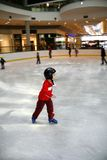 Young boy learning to skate Royalty Free Stock Image