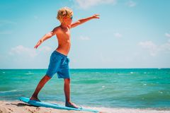Free Young Boy Learning To Surf At Sea Beach Stock Photo - 161783950