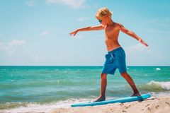 Free Young Boy Learning To Surf At Sea Beach Royalty Free Stock Photography - 161784007