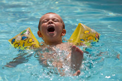 Young boy learning to swim Stock Photo