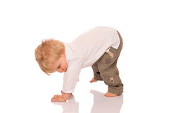 Young boy learning to walk Royalty Free Stock Photo