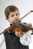 Young boy learns to hold a violin Royalty Free Stock Image