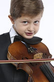 Young boy learns to hold a violin Royalty Free Stock Photography