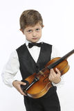 Young boy learns to hold a violin Royalty Free Stock Photos