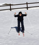 Young boy learns to ski cross-country in winter Stock Image