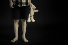 Young Boy with Legs Scars Holding his Teddy Bear Stock Images