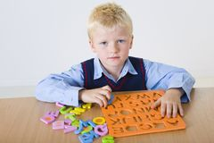 Young boy with letters jigsaw Stock Photography