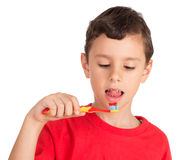 Young Boy Licking Tooth Paste From Teeth Brush Royalty Free Stock Photo