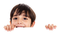 Young boy lifting his head out of the blank board Stock Image