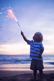 Young boy lighting sparkler Royalty Free Stock Photography