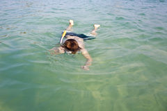 Young boy likes to snorkel Royalty Free Stock Photo