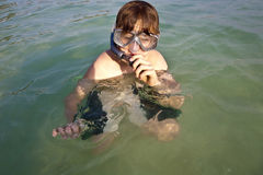 Young boy likes to snorkel Stock Images