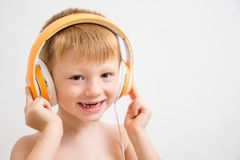 Young boy listen music with headphone Stock Images