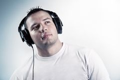 Young boy listening music in headphones Stock Photography