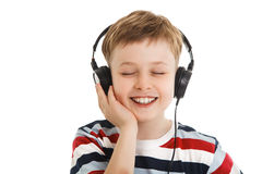 Young boy listening a music in a headphones isolated Stock Image