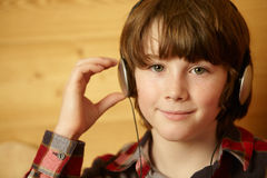 Young Boy Listening To MP3 Player Royalty Free Stock Images