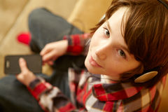 Young Boy Listening To MP3 Player Stock Images