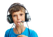 The young boy is listening to music Stock Photo