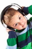 The young boy is listening to music Royalty Free Stock Photography