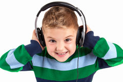 The young boy is listening to music Royalty Free Stock Images