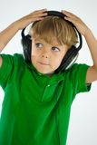 Young Boy LIstening to Music on Headphones Stock Photo