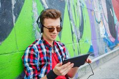 Young boy listening to music Stock Photos