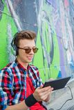 Young boy listening to music Stock Image