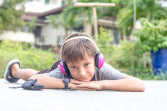Young boy listening to music via headset  Royalty Free Stock Photo