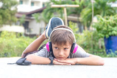 Young boy listening to music via headset  Stock Images