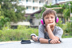 Young boy listening to music via headset Stock Image