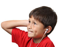 Young boy listens to music on headphones Stock Photos