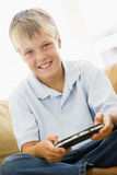 Young boy in living room with video game Royalty Free Stock Image