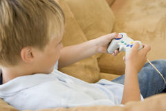 Young boy in living room with video game Stock Image