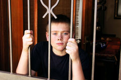 Young Boy Locked Inside House for Protection Royalty Free Stock Photos