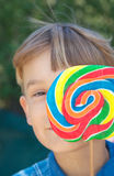 young Boy with lollipop stock photos