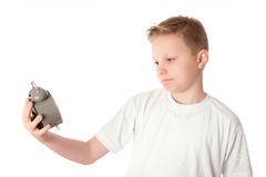 Young boy look the alarm clock over the white Royalty Free Stock Photography