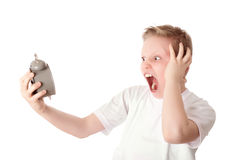 Young boy look the alarm clock over the white Royalty Free Stock Image