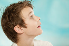 Young boy with a look of anticipation Stock Photo