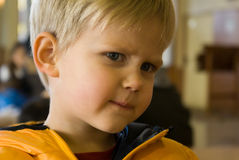Young boy looking annoyed Royalty Free Stock Images