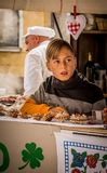 Young boy presenting traditional food on a town festivities royalty free stock images