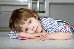 Young boy looking with big eyes Stock Images