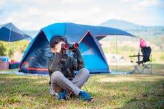 Young boy looking through binocular Stock Image