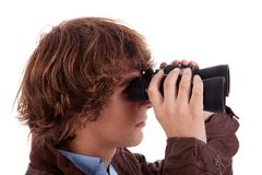 Young boy looking through binoculars Stock Image