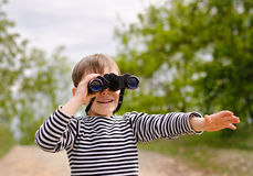 Young Boy Looking Through Binoculars Royalty Free Stock Photography