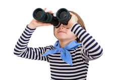 Young boy is looking through binoculars Royalty Free Stock Images