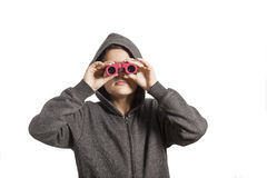 A young boy looking through binoculars Royalty Free Stock Images
