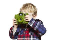Young boy looking through a camera Stock Photo