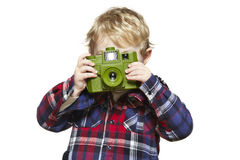 Young boy looking through a camera Stock Photography
